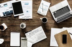 Newspaper, tablet, laptop, charts, calculations, coffee...all important tools that can help you in hiring the perfect local moving company NJ.