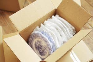 Plates in the box carefully packed.